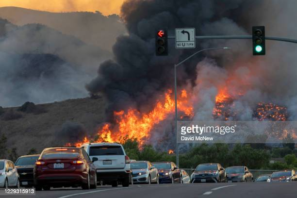 Traffic is diverted off of the 71 freeway during the Blue Ridge Fire on October 27, 2020 in Chino Hills, California. Strong Santa Ana Winds gusting...