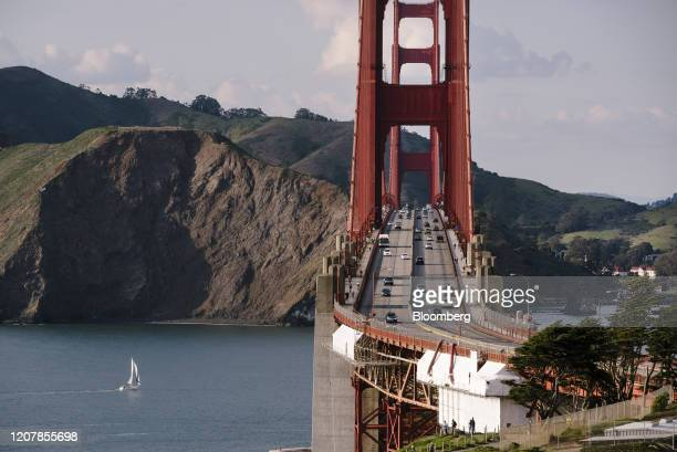 Traffic is light over the Golden Gate Bridge during rush hour in San Francisco, California, U.S., on Friday, March 20, 2020. California Governor...