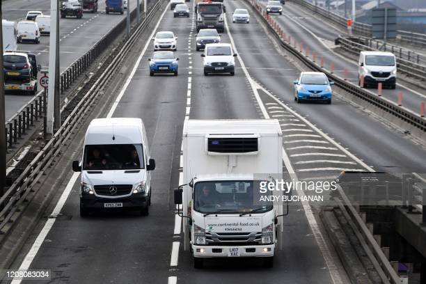 Traffic is seen on a motorway in Glasgow on March 24 2020 after Britain ordered a lockdown to slow the spread of the novel coronavirus Britain was...