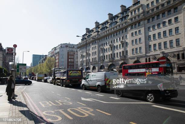 Traffic is seen on Marylebone Road by Baker Street Tube Station on April 14 2020 in London United Kingdom The Coronavirus pandemic has spread to many...