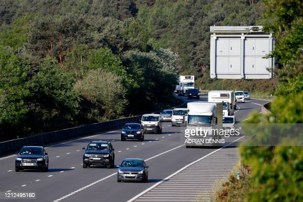 Traffic is seen on the M3 motorway headed toward London during the morning rush hour west of London on May 11 2020 British Prime Minister Boris...
