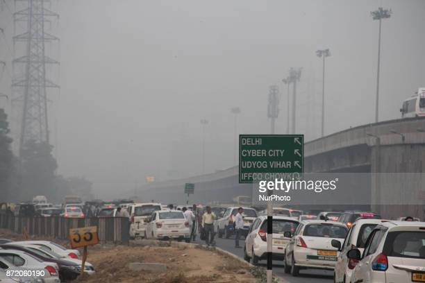 Traffic is seen through heavy smog in New Delhi on November 9 2017 Delhi shut all primary schools as pollution levels hit nearly 30 times the World...