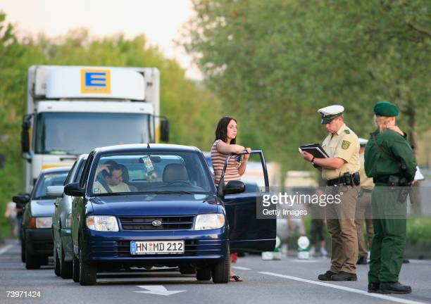 Traffic is stopped and checked as police officers search the scene where two police officers were shot at the Theresienwiese on April 25 2007 in...