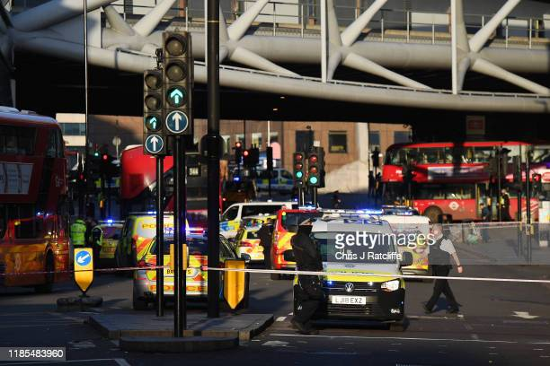 Traffic is stopped and members of the public are held behind a police cordon near Borough Market after reports of shots being fired on London Bridge...
