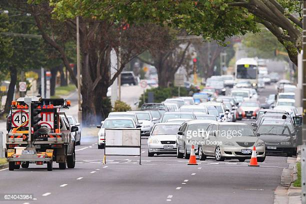 Traffic is stopped near the Springvale Commonwealth Bank branch on November 18 2016 in Melbourne Australia A man allegedly set himself on fire...