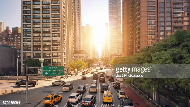traffic jam along queensboro bridge lower roadway and 2nd avenue at 59th street in manhattan, new york city - avenue stock pictures, royalty-free photos & images