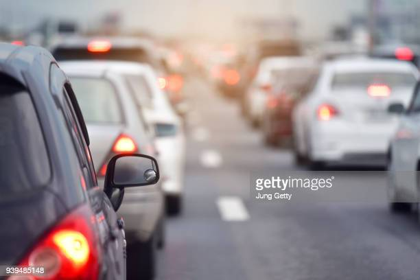 traffic jam at road.background blurred - traffico foto e immagini stock