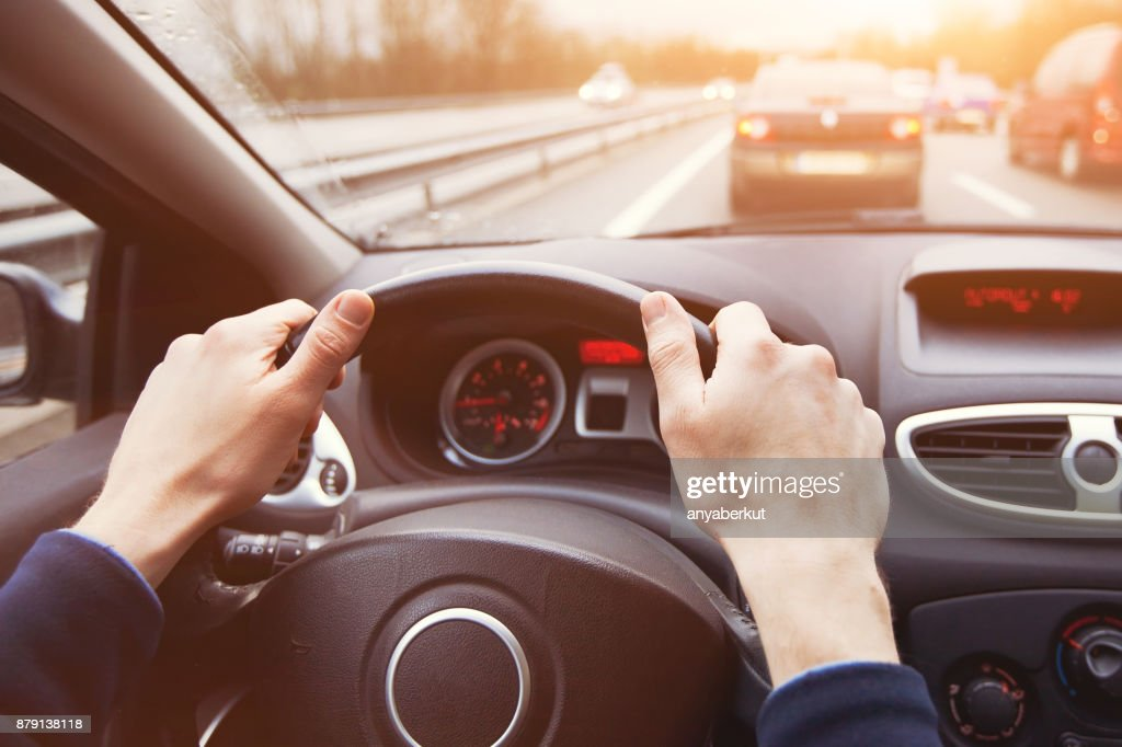 traffic jam, driving car on highway, close up of hands : Stock Photo