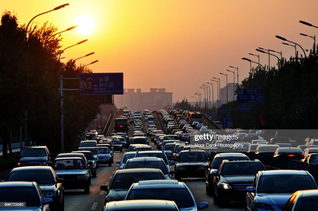 Traffic jam during sunset : Stock Photo