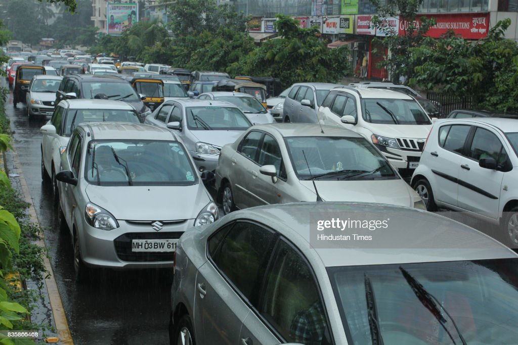 Traffic jam following the heavy rain at Gladys Alvares Road, Vasant Vihar in Thane, on August 19, 2017 in Mumbai, India. These weather conditions have been attributed to the presence of a low pressure which is currently lying over the Vidarbha region. Due to this, moisture incursion has increased over Mumbai as well as Thane and the cities have recorded these heavy spells.