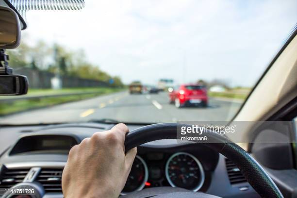 traffic jam from the driver's perspective - dashboard camera point of view stock photos and pictures