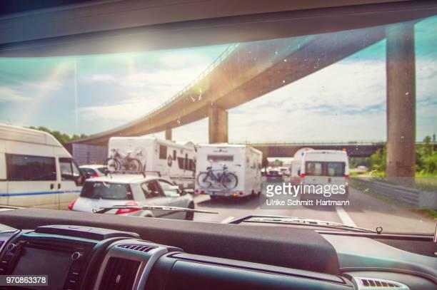 Traffic jam in holiday season as seen through campervans window