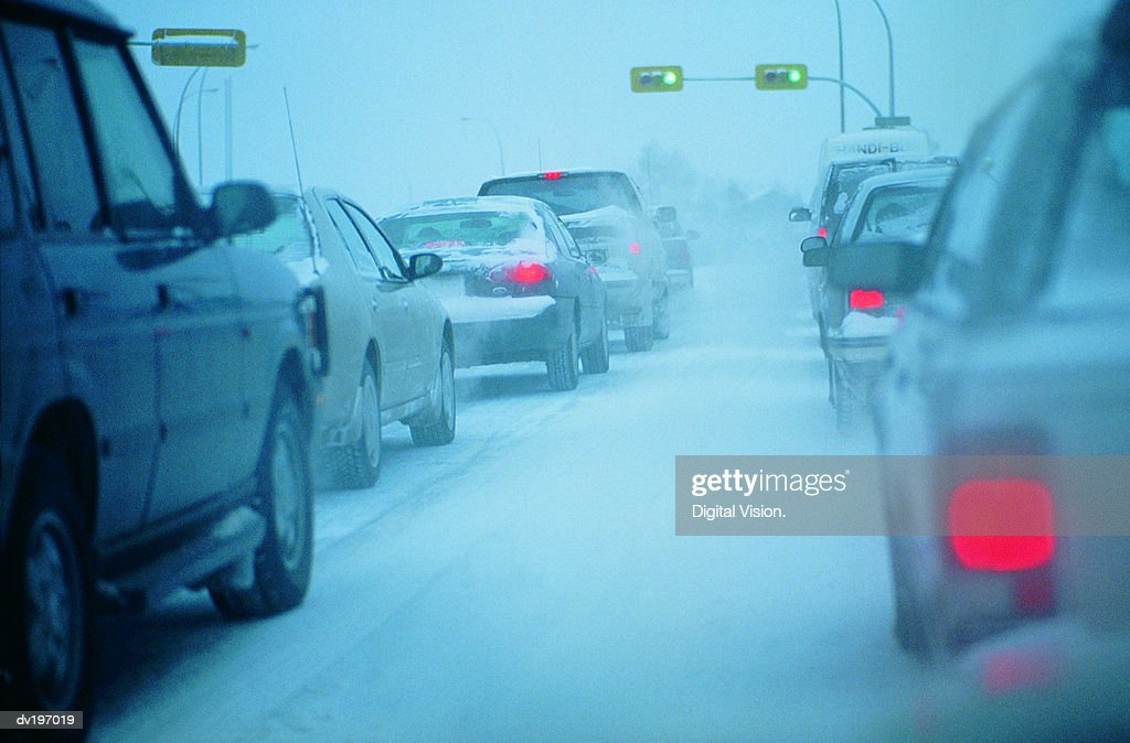 Traffic jam in snowy conditions : Stock Photo