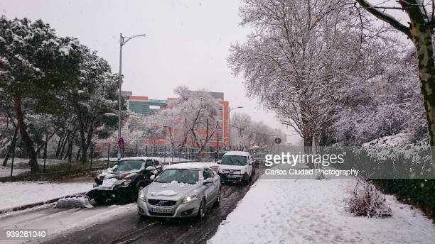 Traffic jam in winter due to the snowfalls in the city center of Madrid, Spain