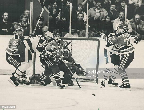 Traffic jam Most of the traffic last night at the Gardens was around Alain Chevrier's goal That's Peter Ihnacak of Leafs between Devils' Doug...