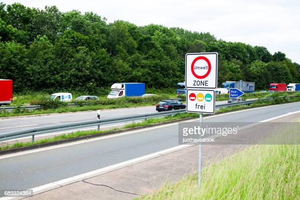 Traffic jam on highway and CO2 road sign