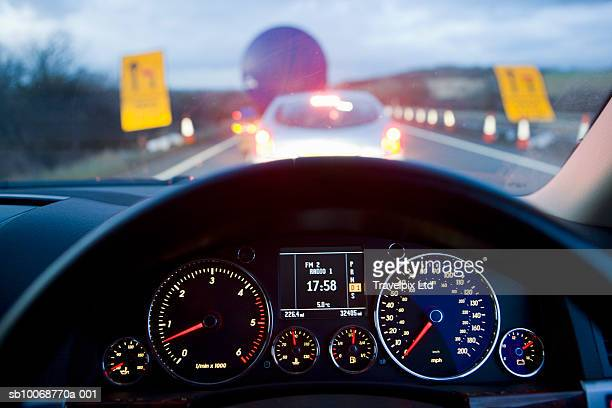 traffic jam on motorway viewed from the drivers seat - dashboard stock pictures, royalty-free photos & images