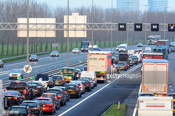 traffic jam on the highway - netherlands stock pictures, royalty-free photos & images