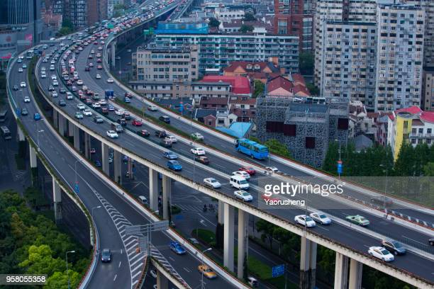 traffic jam on the highway to shanghai city downtown area,china - thruway stock pictures, royalty-free photos & images