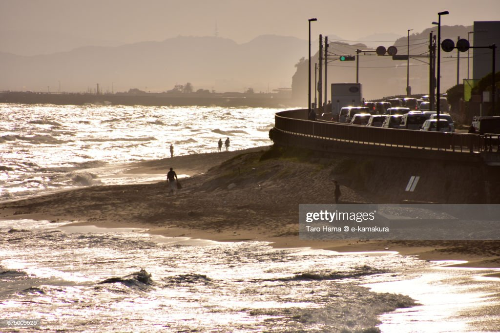 Traffic jam on the route by the sunset beach : ストックフォト