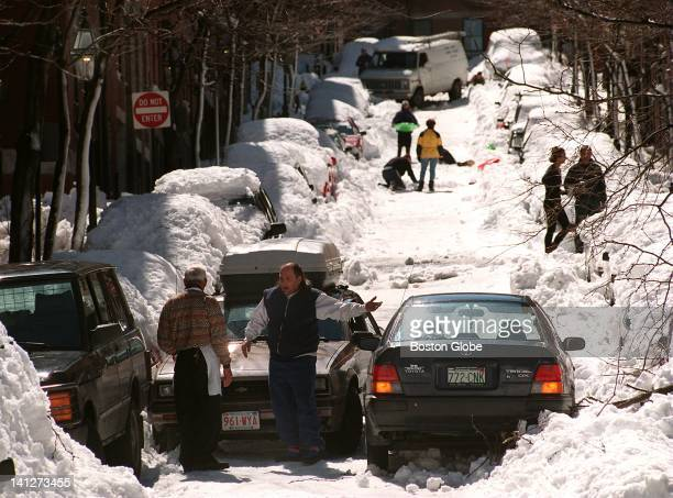 A traffic jam was caused on Garden Street in Beacon Hill after the automobile on the right went up the one way street getting stuck in deep snow that...