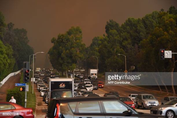Traffic jams up as people flee from Santa Ana winds blowing fire and smoke toward them from the Canyon 2 fire on October 9 2017 in Orange California...