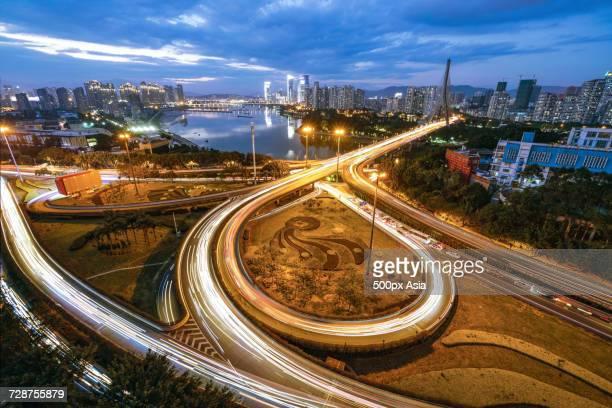 Traffic junction near river at sunset, Fuzhou, Fujian, China