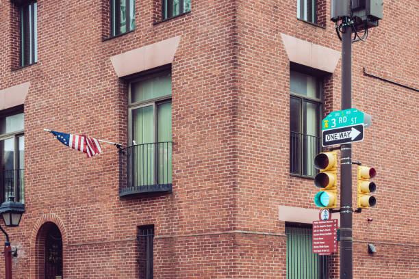 Traffic light against brick walls in Philadelphia historic center