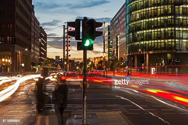 Traffic light and car lights at rush hour in Berlin, Potsdamer Platz