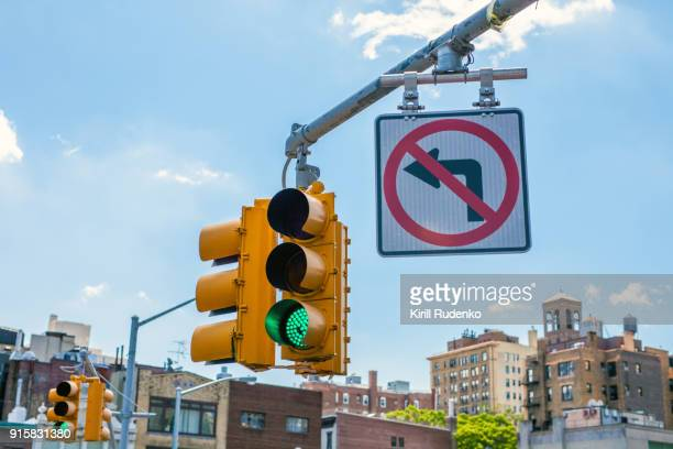 traffic light and road sign in manhattan, new york, usa - road signal stock pictures, royalty-free photos & images