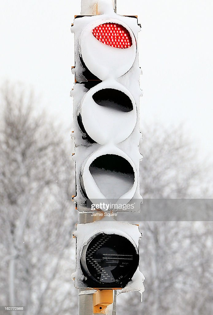 A traffic light is covered in snow after the area is hit by a snowstorm on February 26, 2013 in Kansas City, Missouri. This is the second major snowstorm the midwest has seen this week dropping a half-foot or more of snow across Missouri and Kansas and cutting power to thousands...