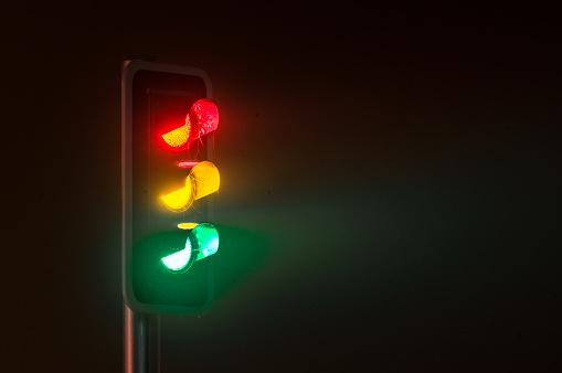 Traffic light on foggy night - gettyimageskorea