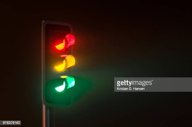 Traffic light on foggy night
