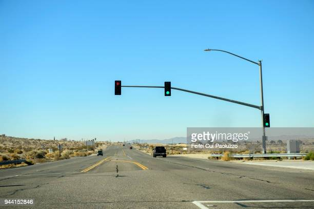 traffic light on the road at barstow, california, usa - stoplight stock pictures, royalty-free photos & images