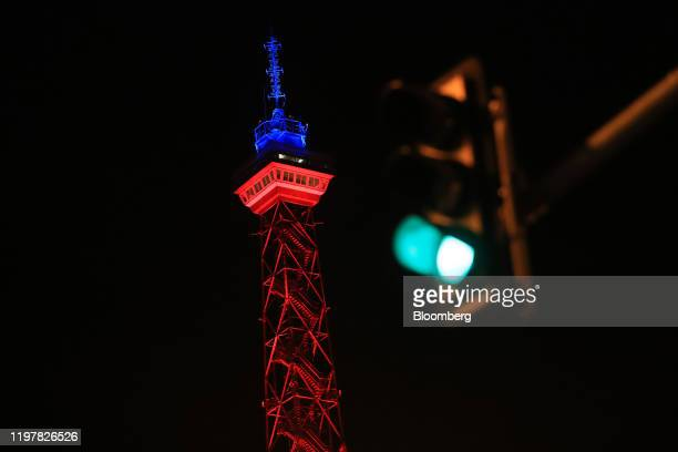 A traffic light shines green near the Radio Tower which has been illuminated in red and blue to mark the day the UK leaves the European Union in...