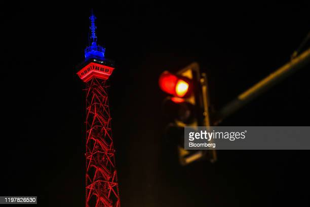 A traffic light shines red near the Radio Tower which has been illuminated in red and blue to mark the day the UK leaves the European Union in Berlin...