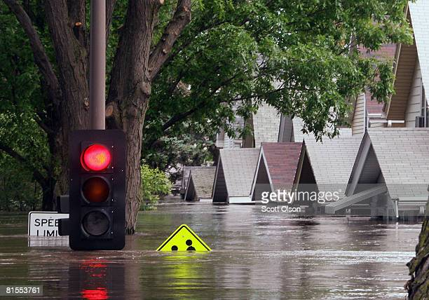 Traffic light shows red above a Flooded street June 13, 2008 in Cedar Rapids, Iowa. The city continues to evacuate residents as water from the...