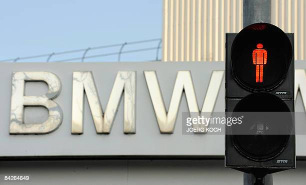 A traffic light shows red in front of the plant of German car maker BMW on January 12 2009 in Munich southern Germany BMW restarted production at the...