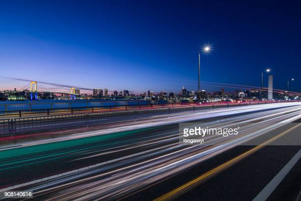 traffic light trails and tokyo city skyline at twilight - isogawyi ストックフォトと画像