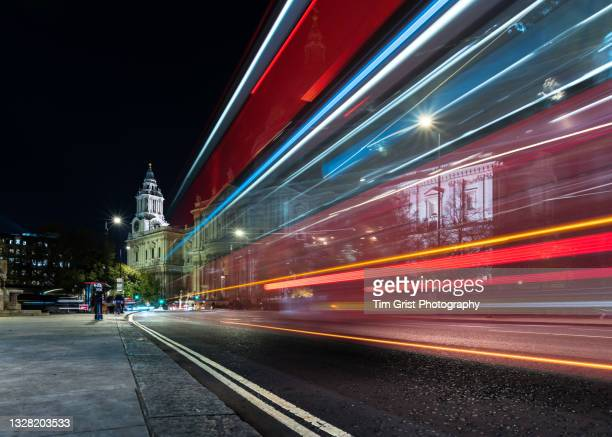 traffic light trails at night along a london street - central london stock pictures, royalty-free photos & images