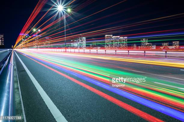 traffic light trails at tokyo waterfront area - isogawyi ストックフォトと画像