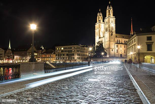 Traffic light trails in Zurich old town at night in Switzerland