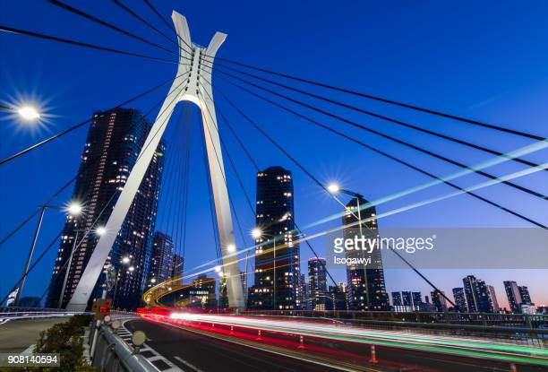 traffic light trails on the bridge - isogawyi stock pictures, royalty-free photos & images