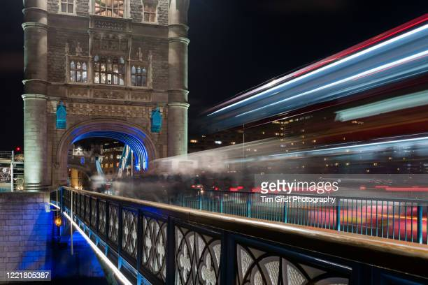 traffic light trails on tower bridge at night, london. uk. - motion stock pictures, royalty-free photos & images