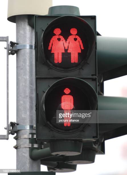 A traffic light with the motive of a homosexual couple pictured in the Konstablerwache square in Frankfurt am Main Germany 14 July 2017 10 such...