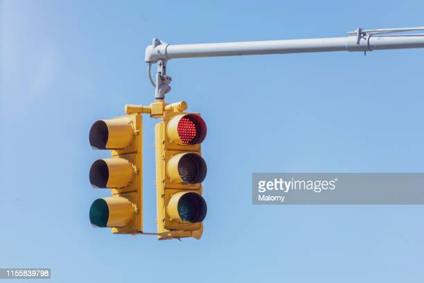 traffic lights against blue sky. - red light stock pictures, royalty-free photos & images