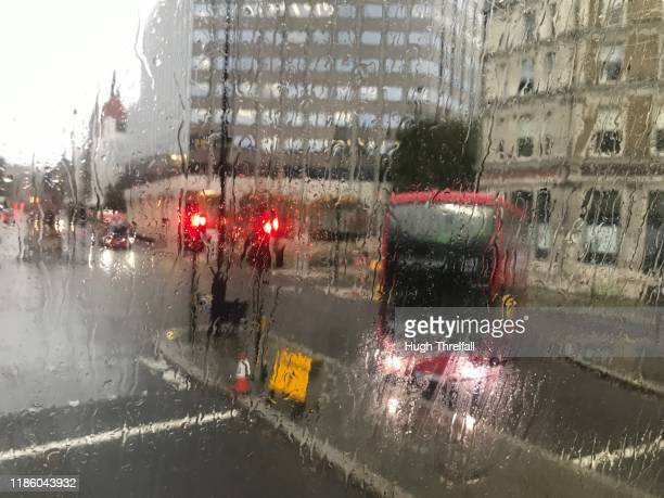 traffic lights and red london bus turning left. - hugh threlfall stock pictures, royalty-free photos & images