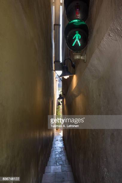 Traffic lights at the narrowest street in Prague, Czech Republic (Mala Strana (Lesser Town) district).