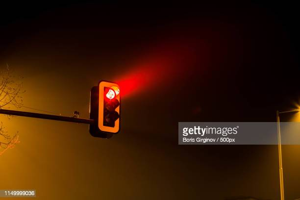 traffic lights by night - red light stock pictures, royalty-free photos & images
