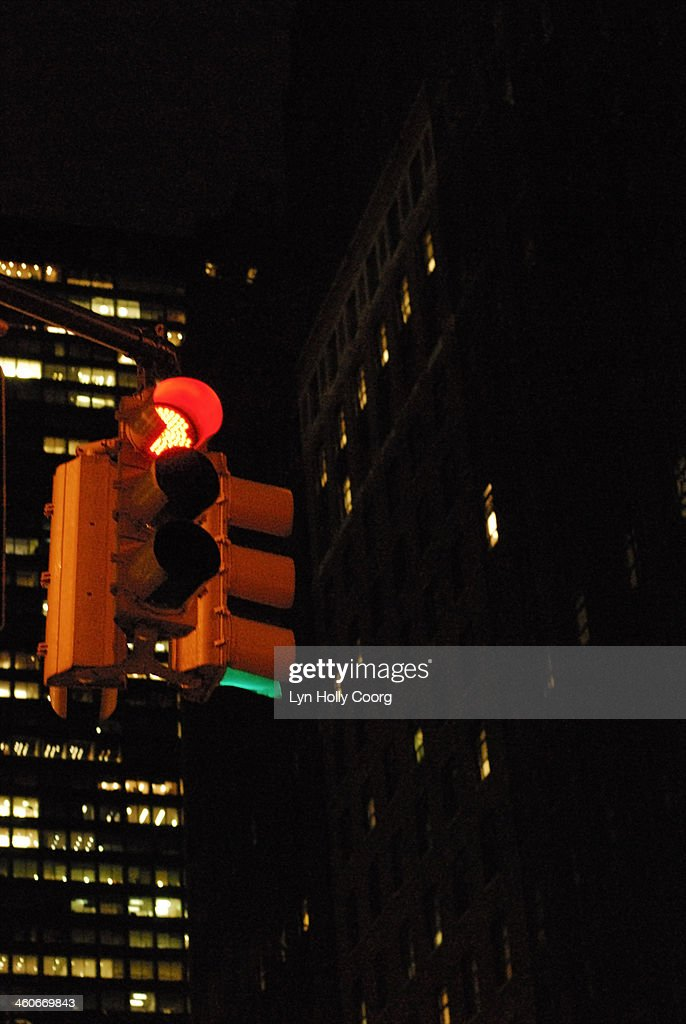 Traffic lights on red in at night in New York City : Stock Photo